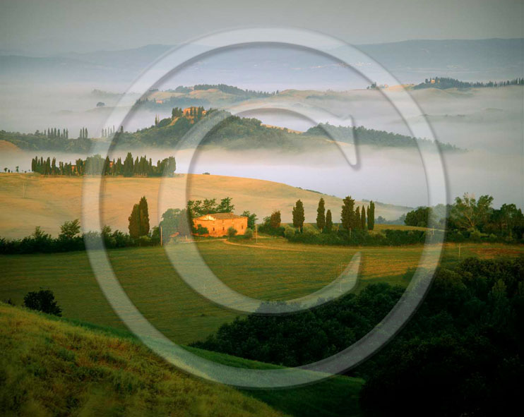 2002 - Landscapes of farm with fog on sunrise in spring, Montemori place, near Asciano village, Crete Senesi land, 18 miles south province of Siena.