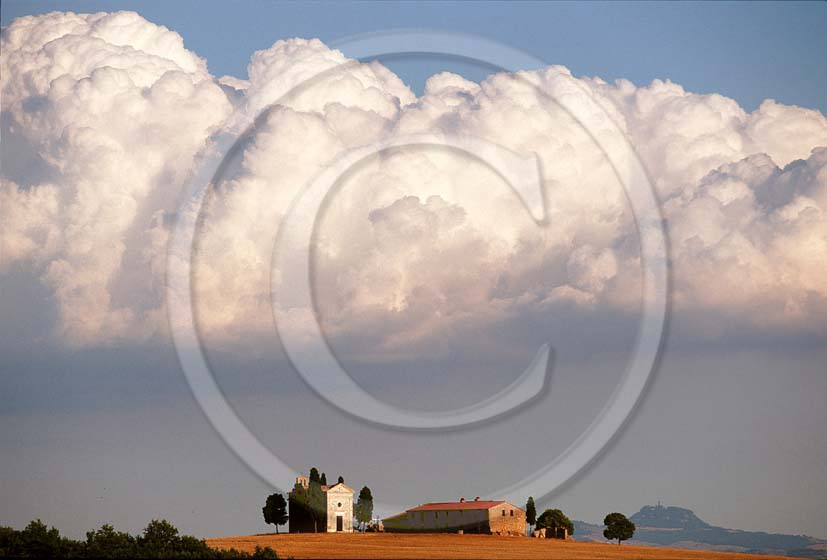 2002 - Landscapes of church and farm with white clouds in summer, near Pienza village, Orcia valley, 20 miles south the province of Siena.