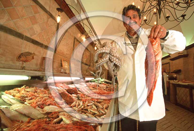 2003 - A fisher shows traditional fishes of Tirreno sea.