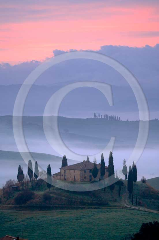 2007 - Landscapes of farm and cipress with fog before sunrise in spring, near S.Quirico village, Orcia valley 21 miles south province of Siena.