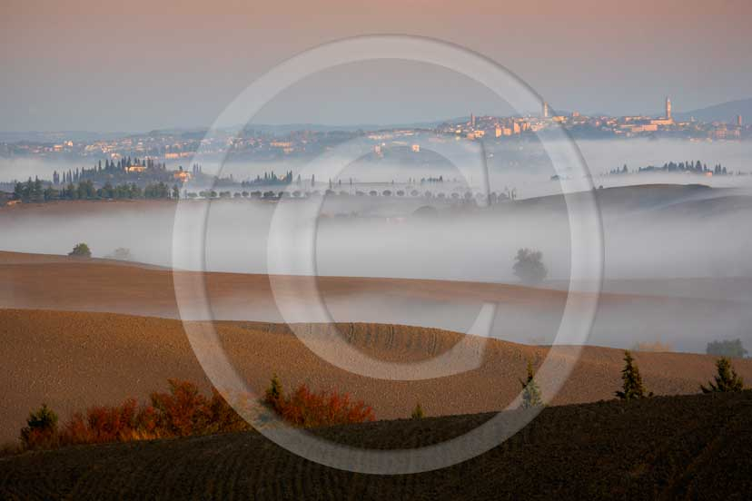 2007 - Landscapes with fog and Siena town in background on sunrise in autumn, near Ville di Corsano place, Crete Senesi land, 14 miles est Siena province.