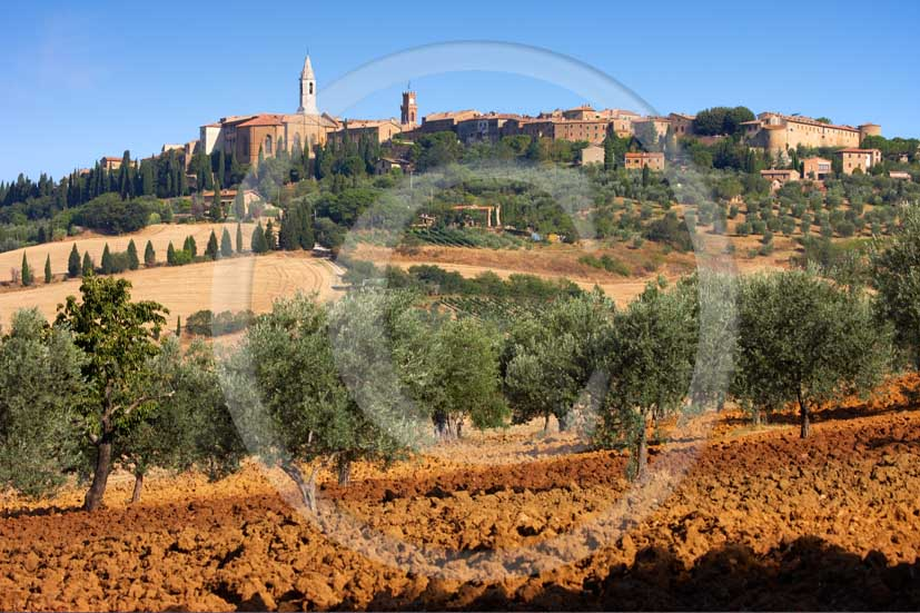 2008 - View of Pienza medieval village on early morning in summer, with brown field of bead and olives, Orcia valley, 20 miles south the province of Siena.
