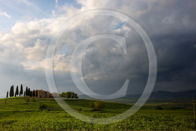2008 - Landscapes and farm with white and black clouds a bit before thunderstorm on spring, near Pienza medieval village, Orcia valley, 20 miles south the province of Siena.
