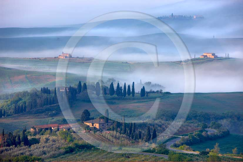 2008 - Landscapes with farm and cypress on early morning at sunrise with fog in spring, in Pienza medieval village, Orcia valley, 20 miles south the province of Siena.