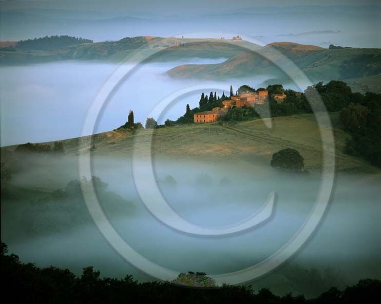 2002 - Landscapes of farm with fog on sunrise in winter, Montemori place, near Asciano village, Crete Senesi land, 18 miles south province of Siena.