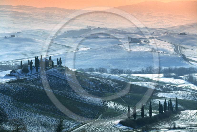 2000 - Landscapes of farm and cipress with snow in winter, near S.Quirico village, Orcia valley, 15 miles south province of Siena.