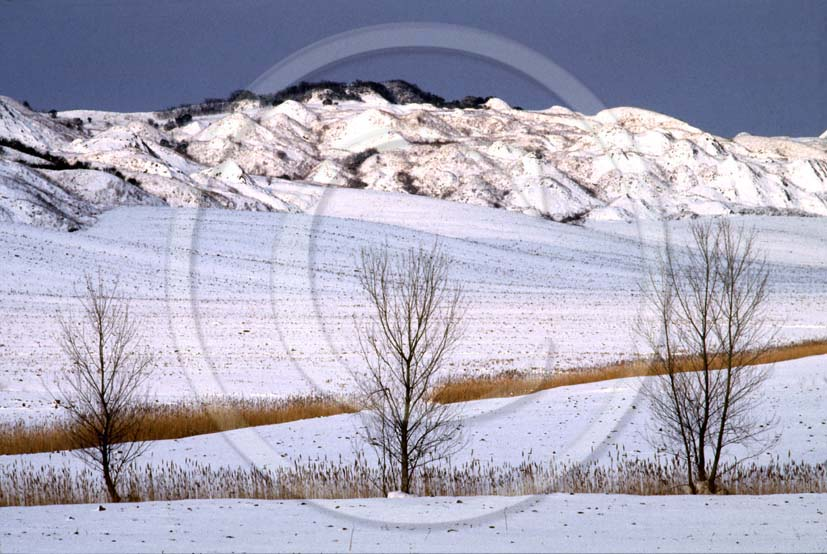 1984 - Landscapes of the Crete Senesi land with snow in winter, near Taverne village, 8 miles south the province of Siena.