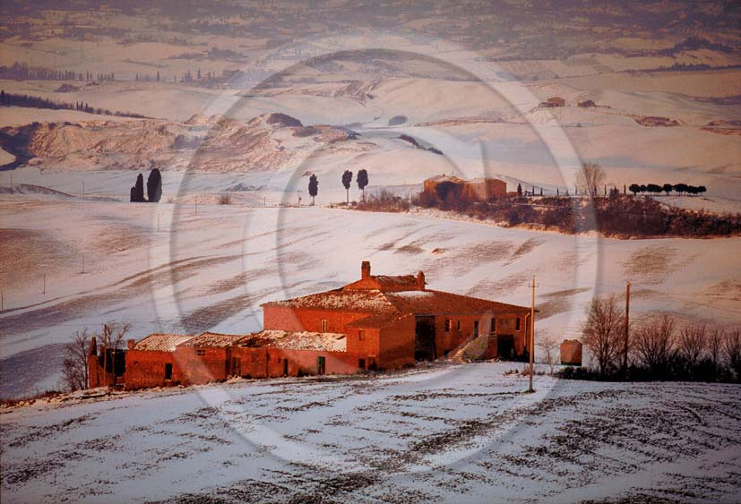 1999 - Landscapes of farm with snow on sunrise in winter, near Mucigliani place, Crete Senesi land, 13 miles south the province of Siena.