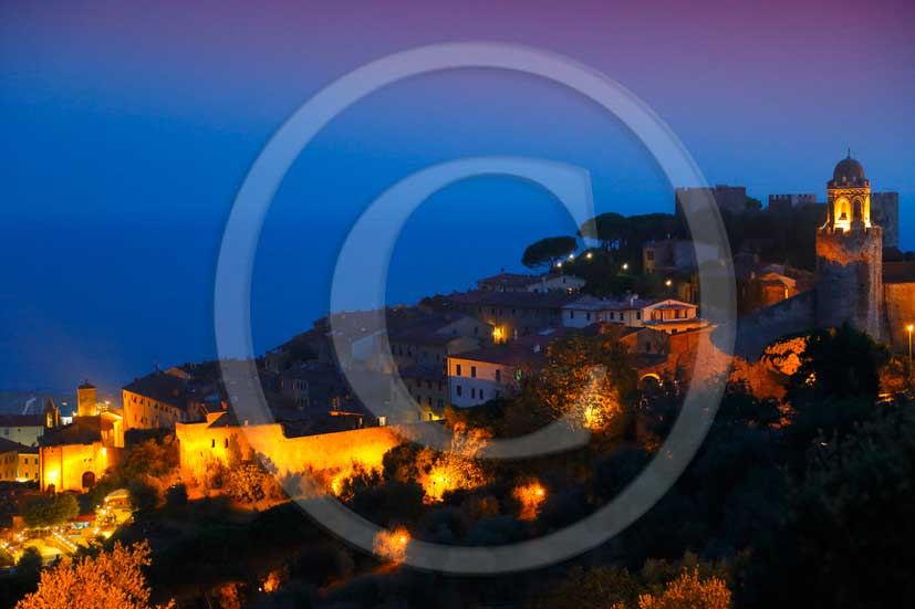 2012 - night view of Castiglione della Pescaia medieval village on Tirreno sea in Maremma land.
