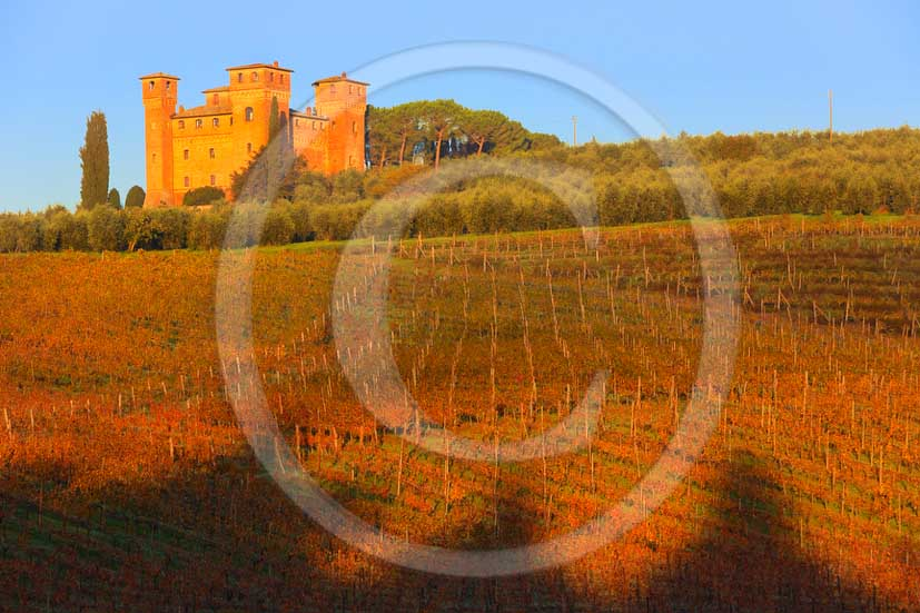2012 - View on sunrise in autumn at Castle of Four Towers and its vineyards near Siena in crete Senesi land.