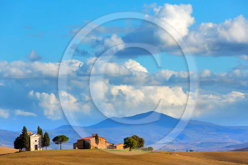 2013 - View on late afternoon in autumn of farm, cypress and little country chapel of Vitaleta in Orcia valley.