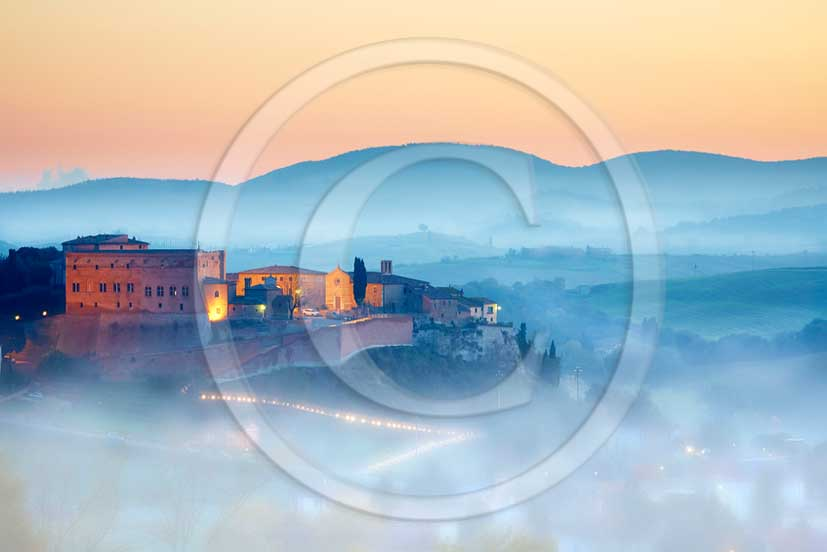 2013 - View on early morning with fog in winter of the castle and village of San Giovanni D' Asso in Crete Senesi land.