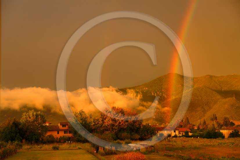 2013- View of country surrounding Pisa town with rainbow and fog just before a thunderstorm.