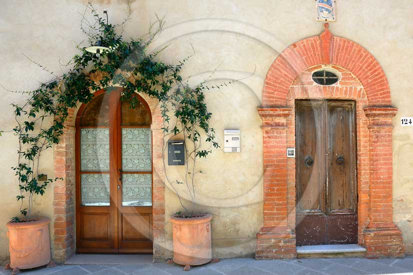 2013 - Traditional tuscan doors with red and yellow Gerani flowers.