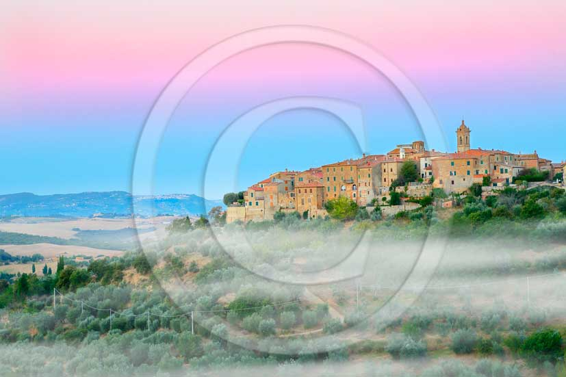 2013 - View before a sunrise with fog of Castelmuzio village in Orcia valley.