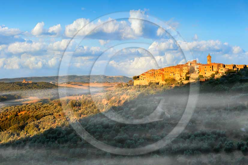 2013 - View at sunrise with fog of Castelmuzio village in Orcia valley.