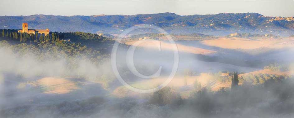 2013 - Panoramic view at sunrise with fog of Orcia valley with Saint Anna in Camprena Monasty near Castelmuzio village.