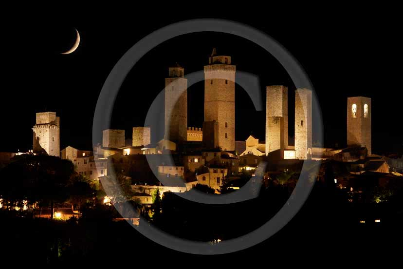 2008 - Night view with moon of S. Gimignano medieval village and the main towers, Chianti land, 20 miles south the province of Florence.