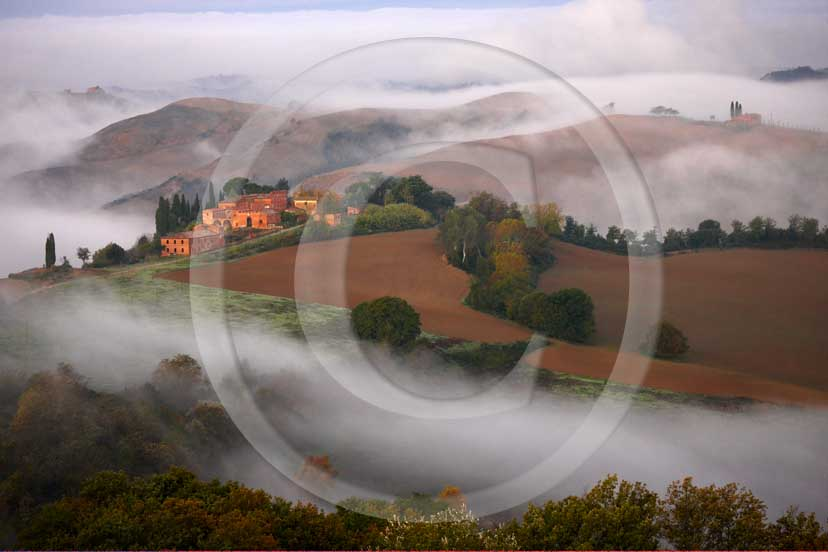 2008 - Landscapes and farm with fog on sunrise in winter, Montemori place, near Asciano village, Crete Senesi land, 18 miles south province of Siena.