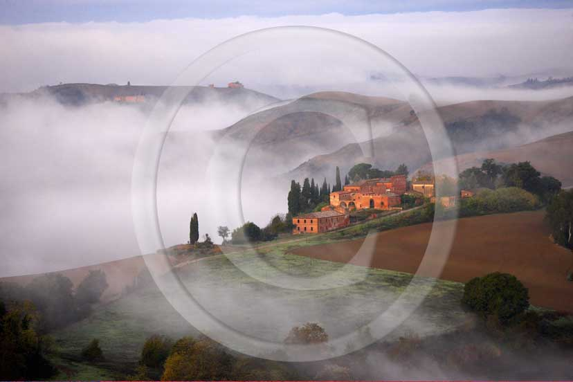 2008 - Panoramic view of landscapes and farm with fog on sunrise in winter, Montemori place, near Asciano village, Crete Senesi land, 18 miles south province of Siena.