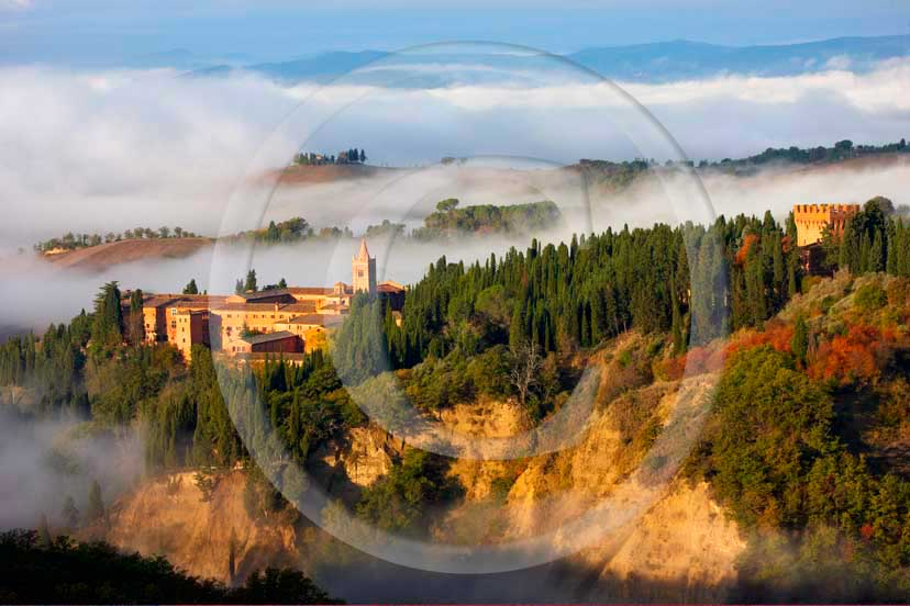 2008 - View of Mount Oliveto Abbay with fog in early morning, near Chiusure village, Crete Senesi land, 22 miles south the province of Siena.