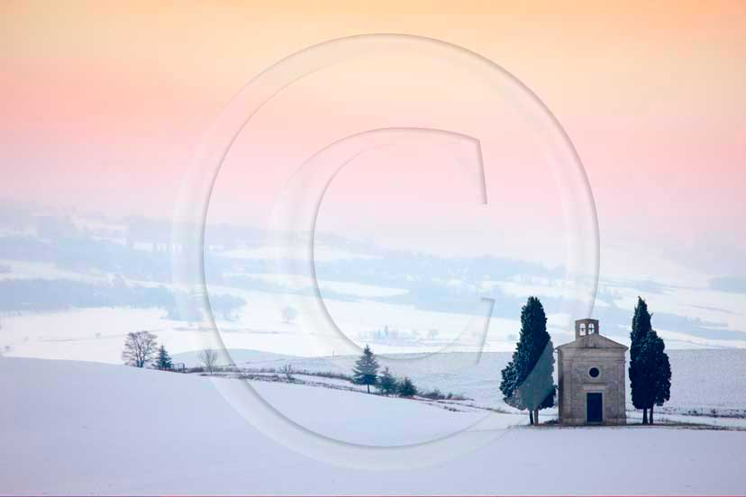 2009 - Landscapes of farm and church with snow on sunset in winter, near Pienza village, 22 miles south province of Siena.<br />