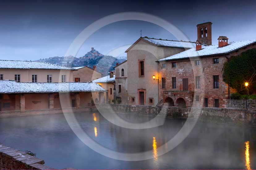 2009 - View of Bagno Vignoni village and the main square of thermal bath with snow in winter, Orcia valley, 27 miles south province of Siena.