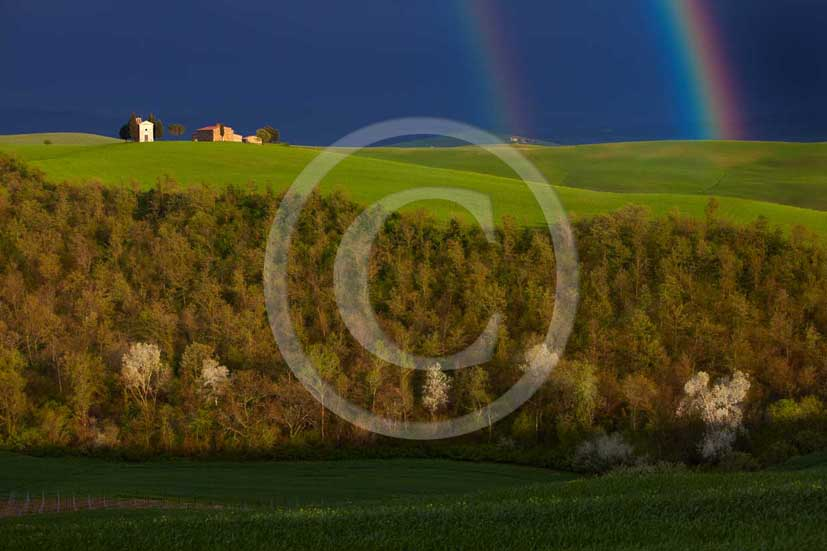 2009 - Landscapes of farm and country church with rainbow a bit after a thunderstorm in spring, near Pienza village, 22 miles south province of Siena.