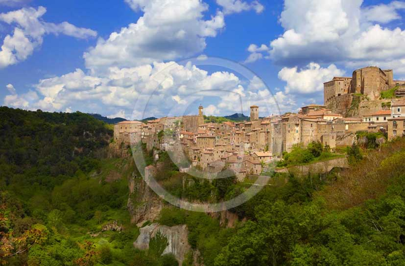 2009 - View of Sorano medieval village in easter with white clouds in blue sky, along Etruschi country road,31 miles south province of Grosseto.