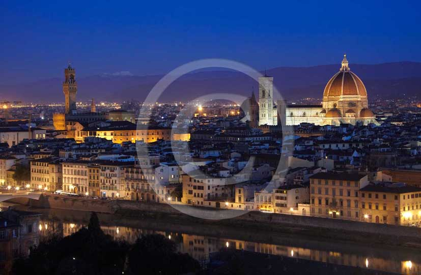 2009 - Night view of Florence town with the Arno river, the tower of the