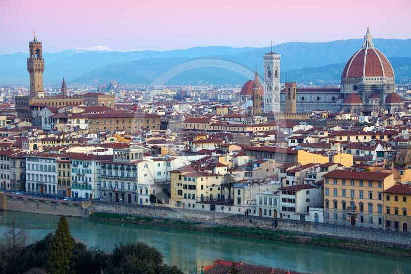 2009 - View of Florence town on sunrise with the Arno river, the tower of the