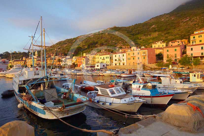 2009 - View of the port and old fisher's boats of Isle of Giglio in early morning on summer, Maremma land, 80 miles south the province of Grosseto.