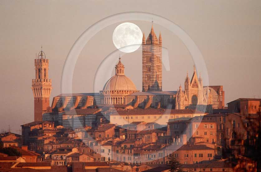 1987 - View of the Siena medieval village on sunrise with moon with the main tower