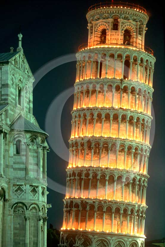 2005 - Night view of the Pisa's leaning tower, right, and the Cathedral, left, lighting with thousands of candles for the S. Ranieri patron of the town.