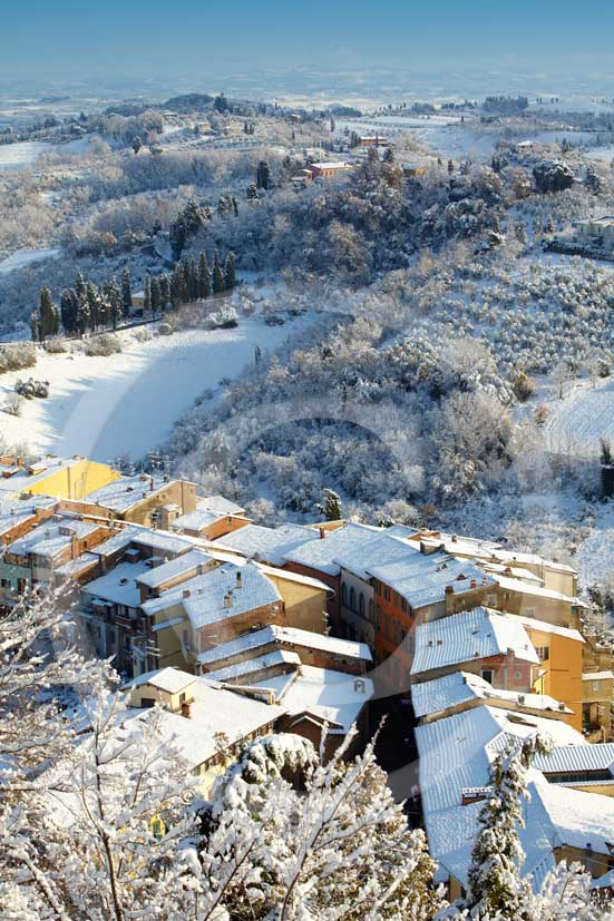 2009 - Surrounding country viewer with the typical tuscan house top under the snow in winter on early morning, near San Miniato village, Era valley, 22 miles east Pisa province.