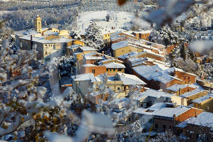 2009 - Surrounding country viewer of San Miniato village with the typical tuscan house top under the snow in winter on early morning, Era valley, 22 miles east Pisa province.