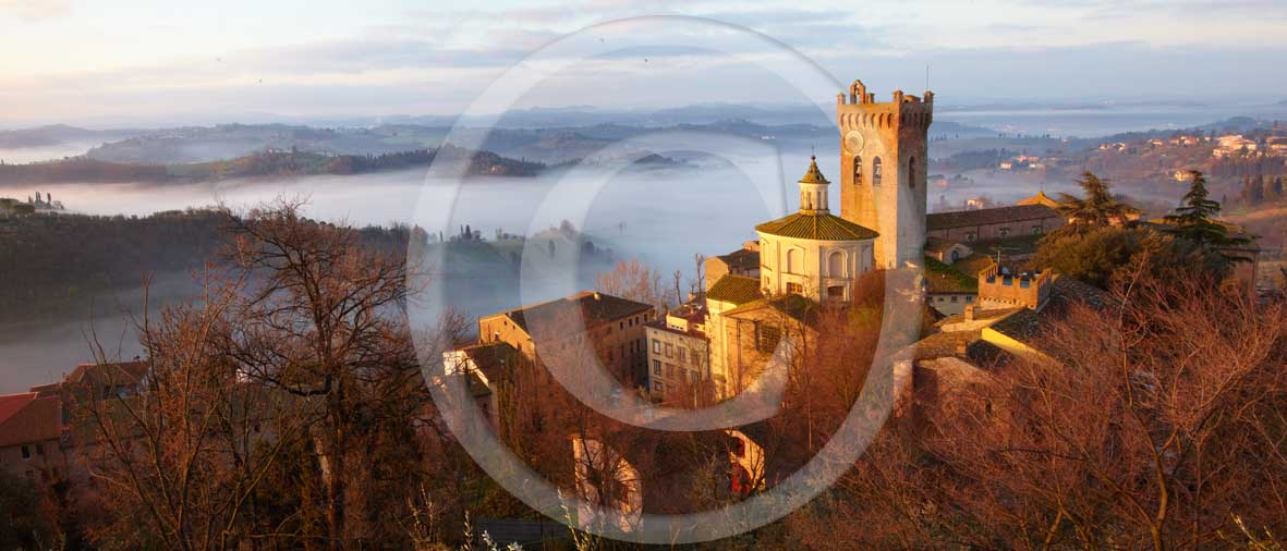 2010 - Panoramic view of San Miniato village on sunrise with fog in spring, Era valley, 18 miles east the Pisa province.