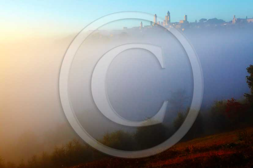2011 - view on sunrise with fog of the tower of San Gimignano village in Chianti Classico land.