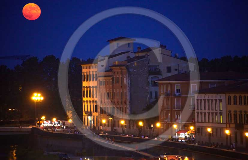 2011 - Night view with red moon of house and buildings in Lungarni of Pisa town.