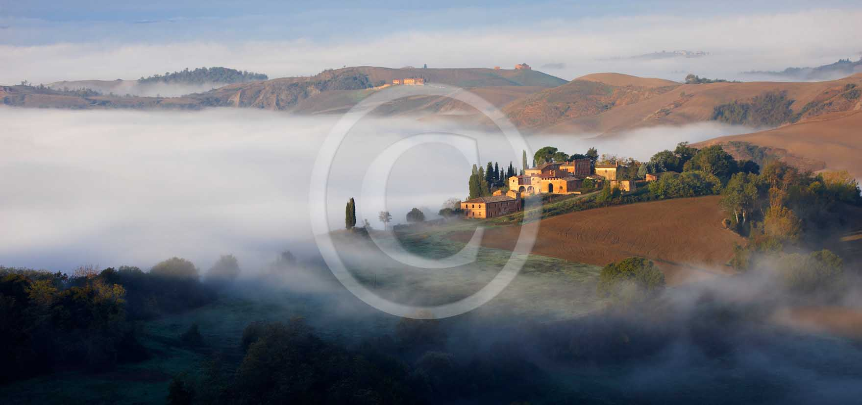 2011 - Panoramic view on surise in autumn with fog at Montemori place in Crete Senesi land.