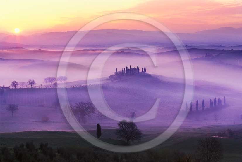 2011 - View in autumn on sunrise with fog of farm and cypress skyline in Orcia valley near San Qurico Orcia.