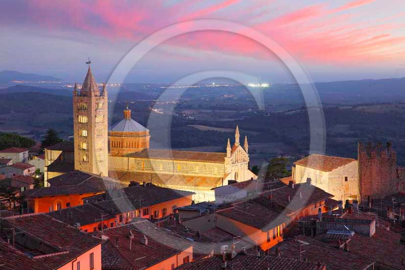 2011 - View on sunset of the cathedral of the Massa Marittima village in Maremma land.
