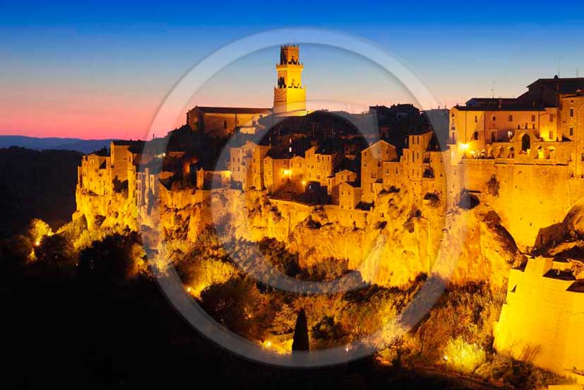 2011 - Night view of the village and wall of Pitigliano in Maremma land.