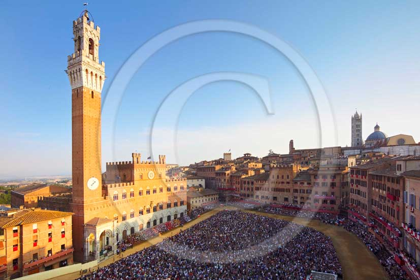 2011 - Aerial view of the main square Il Campo of Siena town with the palace of the Council and the tower during the horse race of the Palio.